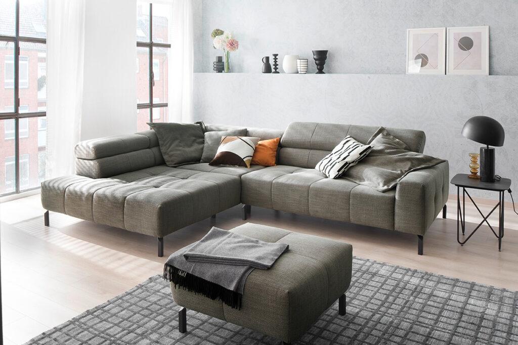 salon ponsaerts meubelen diep hoeksalon design grijs poef